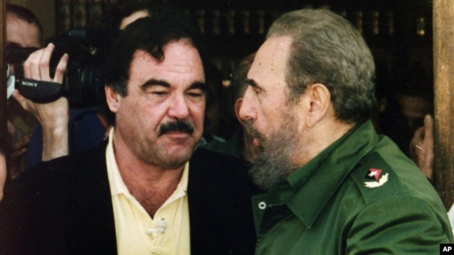 "FILE - Director Oliver Stone and Cuban leader Fidel Castro, Feb. 21, 2002, after wrapping up shooting of a documentary in Ernest Hemingway's preferred bar ""La Terraza"" in Cojimar near Havana, Cuba."