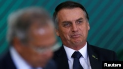 Brazil's President Jair Bolsonaro attends a ceremony at the Planalto Palace in Brasilia, Brazil, Jan. 7, 2019.