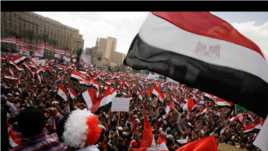 Protesters wave the Egyptian flag in Tahrir Square in Cairo, Egypt, Friday, April 8, 2011.