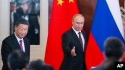 俄罗斯总统弗拉基米尔·普京和中国国家主席习近平于2019年6月5日在莫斯科克里姆林宫会谈后出席了签字仪式。