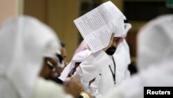 A judge counts votes at a polling station in Kuwait City July 27, 2013.