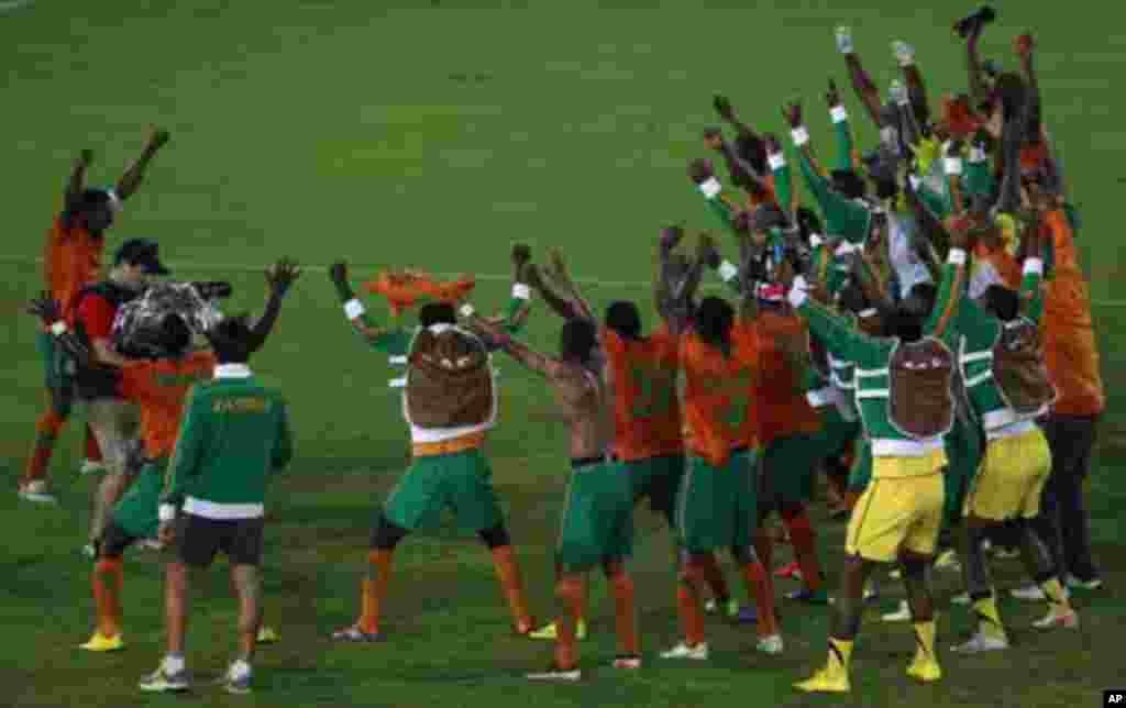 "Zambia's captain Christopher Katongo (L) celebrates with his teammates after winning against Ghana during their African Nations Cup semi-final soccer match at Estadio de Bata ""Bata Stadium"" in Bata February 8, 2012."