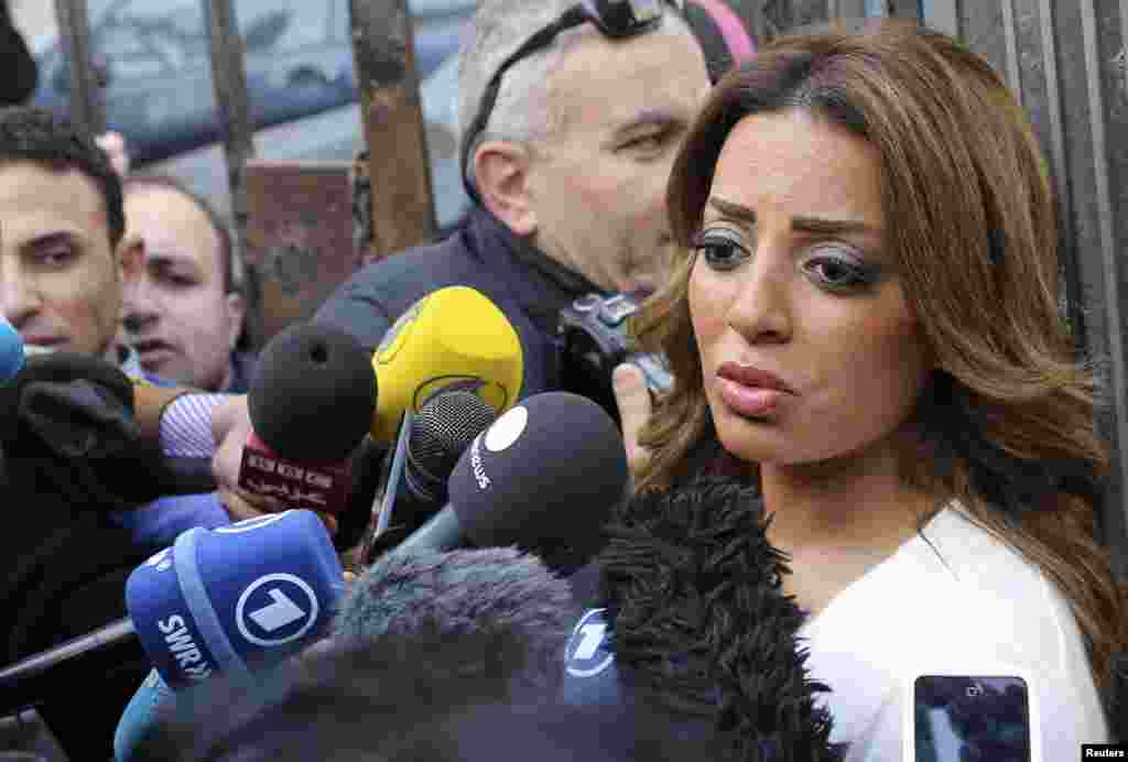 Marwa Omara, fiancee of Canadian-Egyptian Mohamed Fahmy, one of the journalists working for Al Jazeera television, speaks to the media in front of a court in Cairo, Jan. 1, 2015.