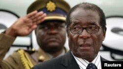 FILE - Zimbabwe President Robert Mugabe attends the launch of basic commodities in Harare, Zimbabwe.