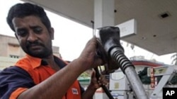 FILE - Man fills up with diesel at a fuel station in Kolkata.