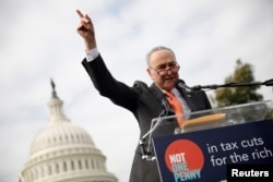 Senate Minority Leader Chuck Schumer speaks during a rally against the Republican tax bill on Capitol Hill in Washington, Nov. 15, 2017.