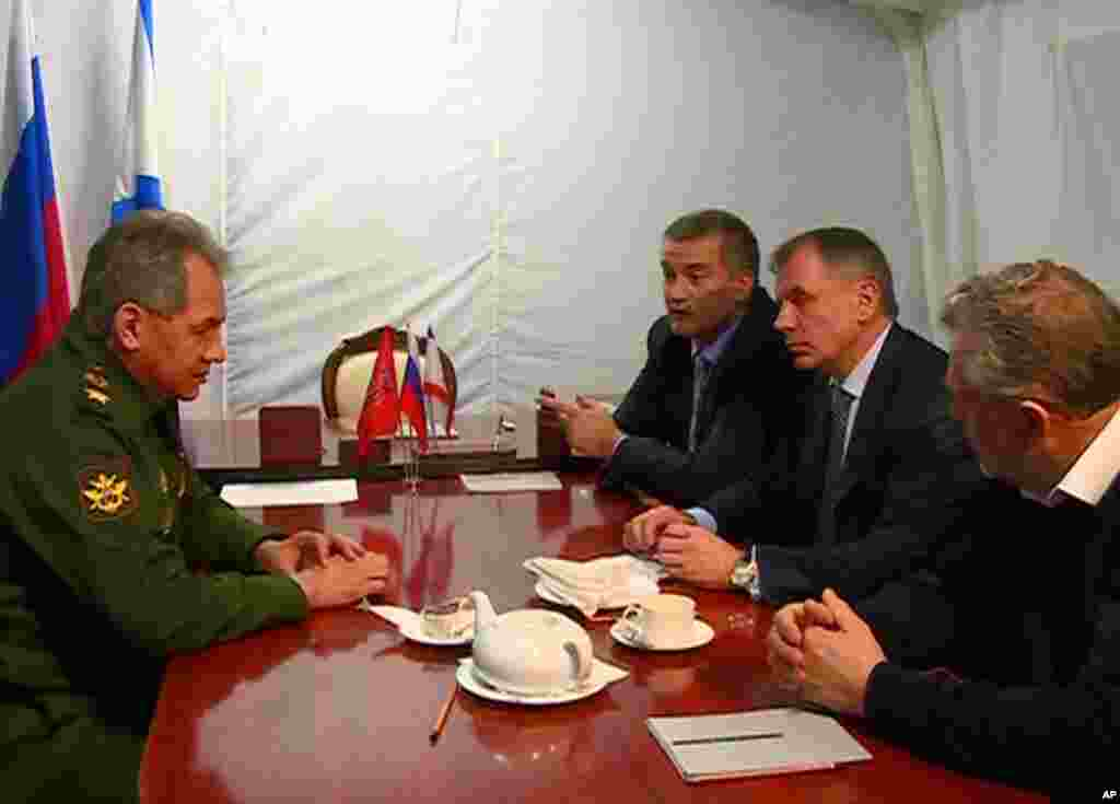 Russian Defense Minister Sergei Shoigu meets with, from left, Crimean Prime Minister Sergei Aksyonov, Speaker of Crimean legislature Vladimir Konstantinov and Sevastopol mayor Alexei Chalyi at a military base in Sevastopol, Crimea, March 24, 2014.