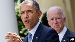 El presidente Barack Obama, acompañado del vicepresidente Joe Biden, habla desde la Rosaleda de la Casa Blanca, sobre la inmigración.