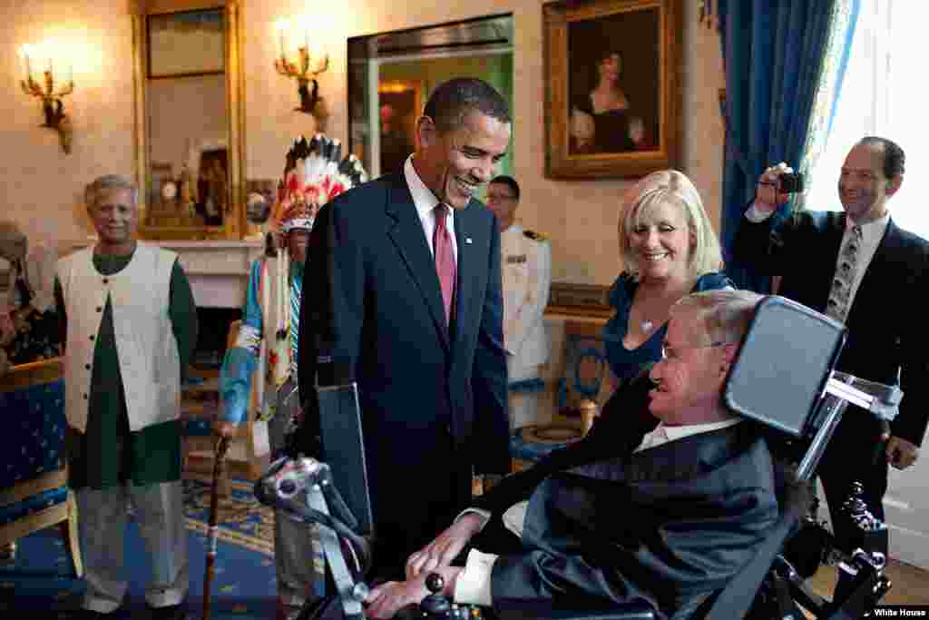 President Barack Obama talks with Stephen Hawking in the Blue Room of the White House before a ceremony presenting him and 15 others the Presidential Medal of Freedom, August 12, 2009. The Medal of Freedom is the nation's highest civilian honor. (Officia