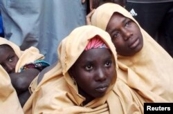 FILE - Some of the newly-released Dapchi schoolgirls are pictured in Jumbam village, Yobe State, Nigeria, March 21, 2018.