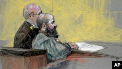 In this courtroom sketch, Maj. Nidal Hasan, right, appears at the Lawrence William Judicial Center during the sentencing phase of his trial, Aug. 27, 2013, in Fort Hood, Texas.
