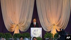 Chinese President Hu Jintao speaks at a dinner held in his honor in Chicago, Illinois, 20 Jan 2011