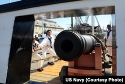 Sailors assigned to USS Constitution perform a War of 1812-era long gun drill in Charlestown Navy Yard, as part of Constitution's weekend festivities celebrating the U.S. Navy's 240th birthday, Oct. 10, 2015.