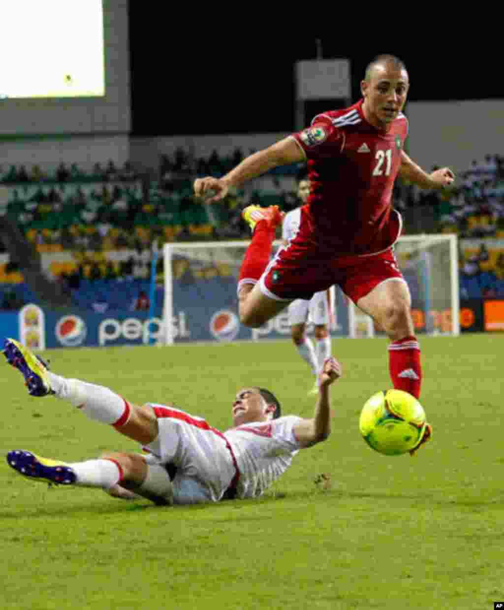 Morocco's Noureddine drives the ball over Tunisia's Ammar during their African Cup of Nations soccer match in Libreville