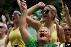 FILE - Demonstrators shout anti-government slogans during a march in March 2015 demanding the impeachment of Brazil's President Dilma Rousseff.