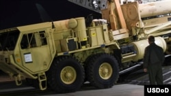 The first elements of a Terminal High Altitude Area Defense system (THAAD) to be installed in South Korea are unloaded from a U.S. military cargo plane, March 6, 2017.