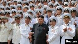 North Korean leader Kim Jong Un (C) poses with officers and sailors of Korean People's Army in Pyongyang June 16, 2014.