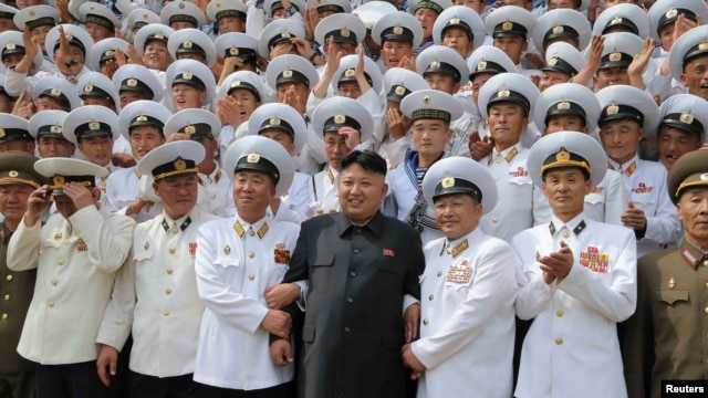 FILE - North Korean leader Kim Jong Un (C) poses with officers and sailors of Korean People's Army in this undated photo released by North Korea's Korean Central News Agency (KCNA) in Pyongyang, June 16, 2014.
