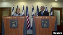 Israel's Prime Minister Benjamin Netanyahu (R) and U.S. Secretary of State Hillary Clinton deliver joint statements in Jerusalem November 20, 2012. The United States signalled on Tuesday that a Gaza truce could take days to achieve after Hamas, the Palest