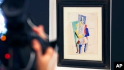 Picasso's 1914 cubist drawing L'Homme au Gibus, Man with Opera Hat, is presented at Sotheby's auction house in Paris, Dec. 12, 2013.
