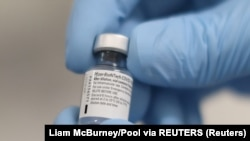 A vial of the Pfizer/BioNTech COVID-19 vaccine is seen ahead of being administered at the Royal Victoria Hospital, on the first day of the largest immunisation programme in the British history, in Belfast, Northern Ireland December 8, 2020. Liam McBurney/Pool via REUTERS