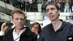 France 3 television journalists Herve Ghesquiere (L) and Stephane Taponier (R) speak during a gathering to celebrate their arrival at France Television headquarters in Paris, June 30, 2011.