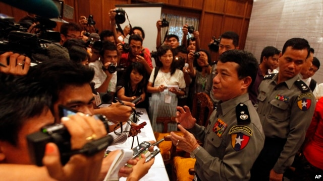 Burma's police chief Zaw Win, second from right, talks to journalists during a press conference regarding recent explosions, Oct 18, 2013, at Rangoon Region government office in Rangoon, Burma.