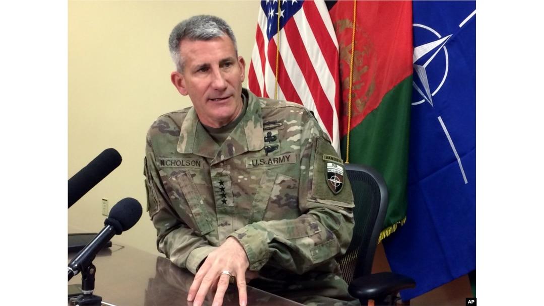 FILE - Gen. John Nicholson, the top American commander in Afghanistan, speaks to reporters, March 14, 2018, at Bagram air base north of Kabul, Afghanistan.