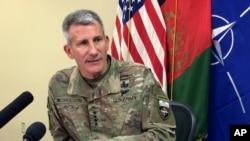 FILE - Gen. John Nicholson, the top American commander in Afghanistan, speaks to reporters at Bagram air base north of Kabul, Afghanistan, March 14, 2018.