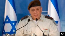 FILE - Israeli Chief of Staff Gadi Eizenkot speaks during a ceremony at the Prime Minister's office in Jerusalem, Feb. 16, 2015.