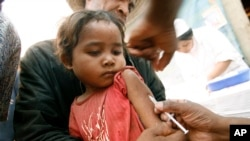 FILE - A Malagasy child receives a vaccination at a makeshift village clinic in Antanetikely, Madagascar.