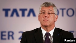 FILE - Karl Slym, managing director of Tata Motors, looks on during a news conference to announce their second quarter results in Mumbai, Nov. 8, 2013..