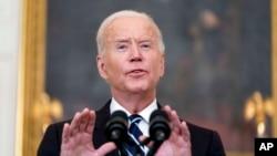 FILE - President Joe Biden speaks in the State Dining Room at the White House, Sept. 9, 2021.