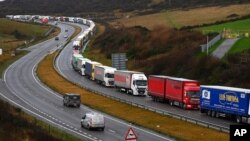Trucks queue in Dover, England, Dec. 11, 2020. The U.K. left the EU on Jan. 31, but remains within the bloc's tariff-free single market and customs union until the end of the year.