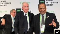 Newly-appointed World Anti-Doping Agency (WADA) president Craig Reedie, center, with his vice-president Makhenkesi Stofile, right, and the outgoing president John Fahey, in Johannesburg, Nov. 15, 2013.