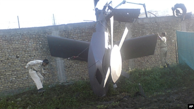Part of a damaged helicopter is seen lying near the compound after U.S. Navy SEAL commandos killed al-Qaida leader Osama bin Laden in Abbottabad, Pakistan, May  2, 2011.