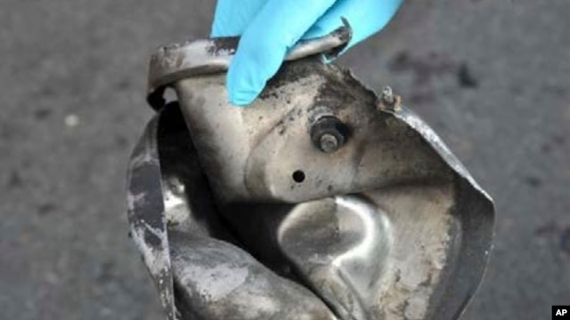 Remains of pressure cooker that FBI says was part of one of the bombs that exploded during the Boston Marathon, April 17, 2013.