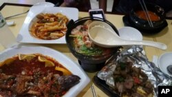 This photo shows North Korean-recommended dishes at the Pyongyang A Ri Rang Restaurant in Bangkok, Thailand, Feb. 18, 2016.
