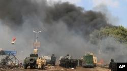 埃及安全部隊檢查穆爾西支持者建立的營地