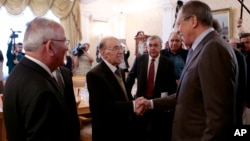 Russian Foreign Minister Sergey Lavrov, right, shakes hands with members of the Syrian delegation prior to a meeting with Qadri Jamil, former deputy prime minister representing Syria's opposition Popular Front of Change and Liberation, in Moscow, Aug. 31, 2015.