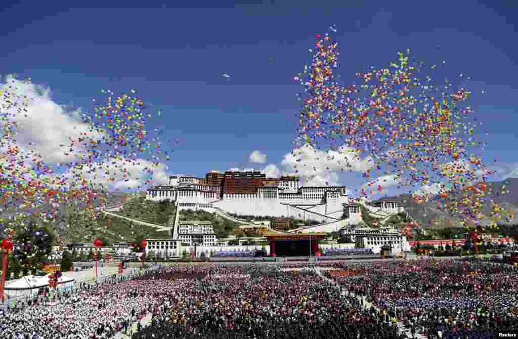Balloons are released during the celebration event at the Potala Palace marking the 50th anniversary of the founding of the Tibet Autonomous Region, in Lhasa, Tibet Autonomous Region.