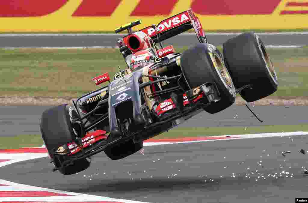 Lotus F1 team driver Pastor Maldonado goes off the track after colliding with Sauber driver Esteban Guitiererrez during the British Grand Prix at the Silverstone Race Circuit, central England.