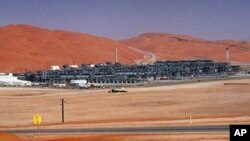 FILE - Industrial plant strips natural gas from crude oil at Saudi Aramco's Shaybah oil field, Shaybah, Saudi Arabia.