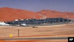 FILE - Industrial plant strips natural gas from crude oil at Saudi Aramco's Shaybah oil field, Shaybah, Saudi Arabia.