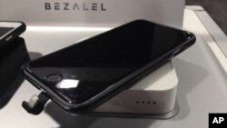 A charging case for an iPhone 6 sits on a wireless charger, both made by Bezalel, at the Sands Expo during the CES International gadget show in Las Vegas, Jan. 7, 2016.