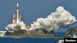 An H-2A rocket carrying an intelligence-gathering satellite successfully takes off from the Tanegashima Space Center in Kagoshima Prefecture, Japan in this photo taken by Kyodo February 27, 2018.
