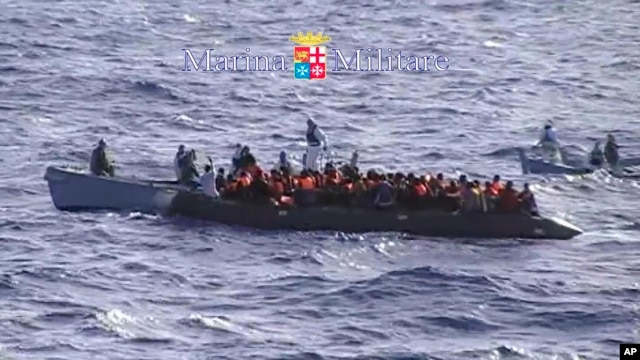 Migrants receive help from the Italian Navy  off the Sicilian island of Lampedusa Oct.12, 2013.