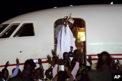 FILE - Gambia's defeated leader Yahya Jammeh waves to supporters as he departs from Banjul airport, Jan. 21, 2017.