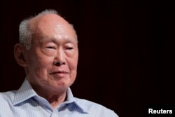 FILE - Former Singapore Prime Minister Lee Kuan Yew (LKY) smiles as he attends the LKY School of Public Policy 7th anniversary dialogue session in Singapore September 14, 2011.