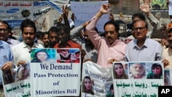 Activists call for protection of Hindu girls at a protest in Hyderabad, Pakistan, March 26, 2019. A court in Islamabad has ordered protection for two sisters from the minority Hindu community as investigators work to determine whether the two were abducted and forced to convert.